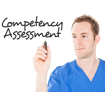 "Man writing ""Competency Assessment"" on invisible board in front of him, facing the camera."